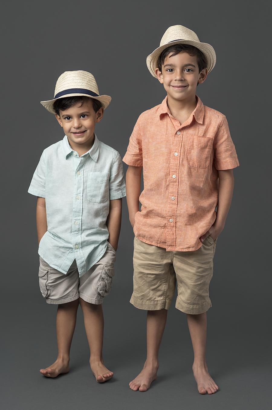 Portrait of two young boys wearing fadoras