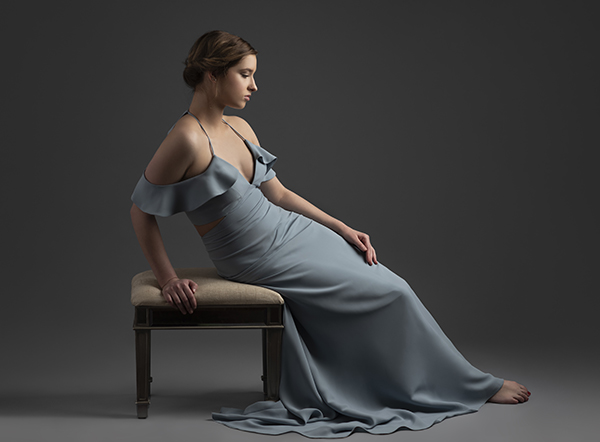 Elegant high school senior portrait in studio wearing Chloe Dao gown.