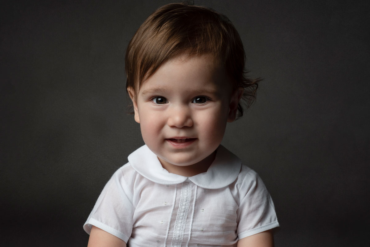 Boy in white peter pan color romper