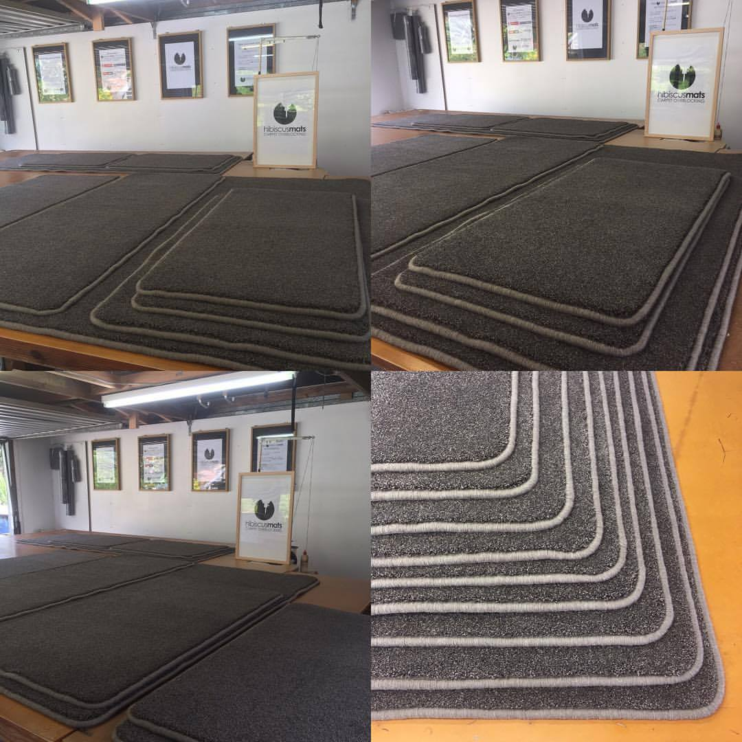 9 Custom made carpet mats edged in charcoal grey