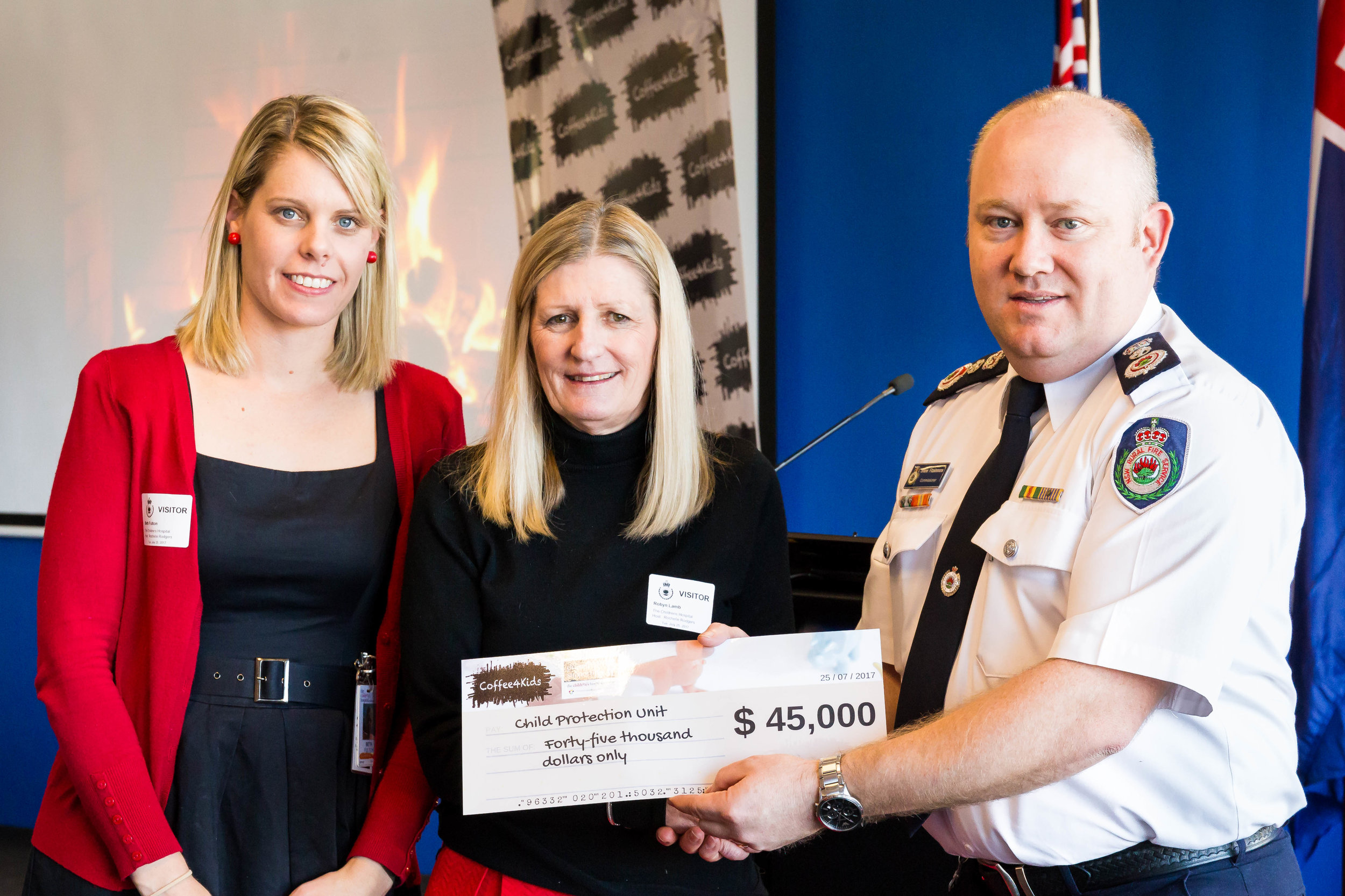 Coffee4Kids patron, NSW RFS Commissioner Shane Fitzsimmons, presents a cheque to the Child Protection Unit.