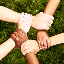 Peaceful-pentagon-five-clasped-multiethnic-hands-on-grass-000034105800_Small.jpg