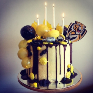 A vanilla and passionfruit football cake for my 12yo cousin who is a BIG fan of the Richmond Tigers!