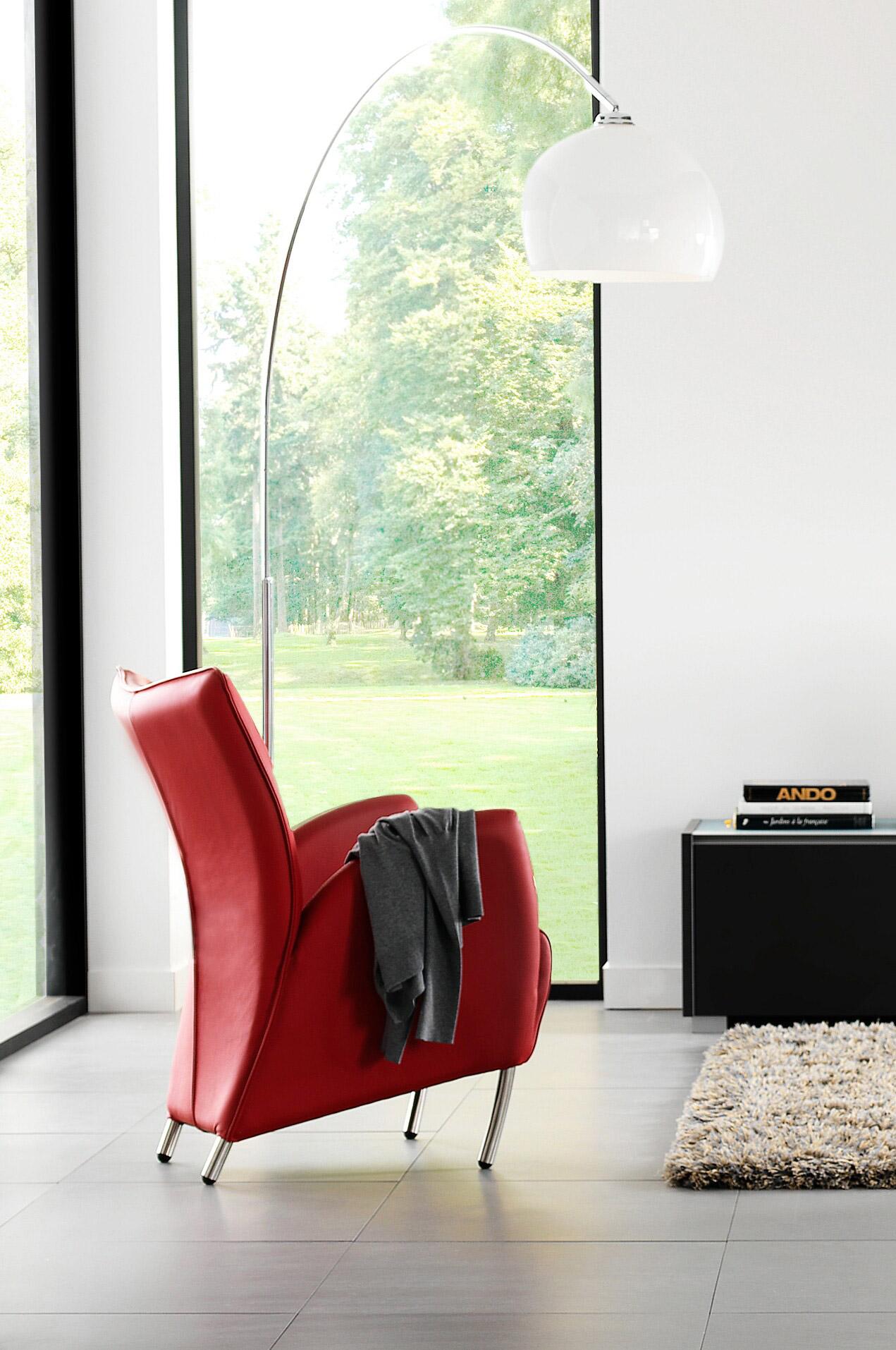 Tulip - Denne flotte stolen er inspirert av Nederlands tulipaner.Vi har den inne på lager i både sort og oransje skinn.
