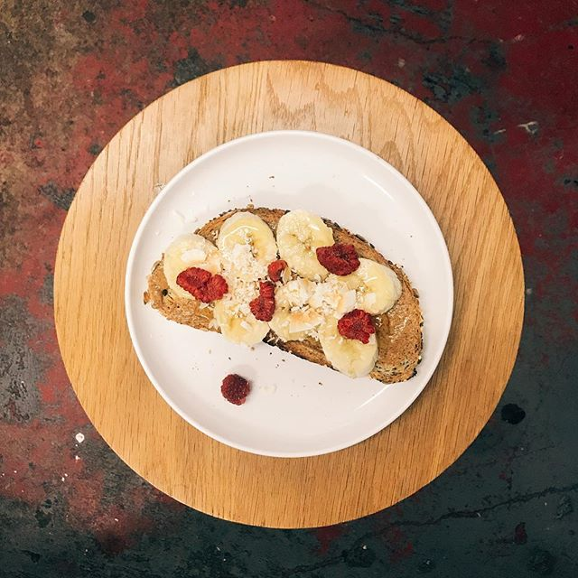 #breakfasts of champions! Available now at our 226 Great Portland Street bakery - #banana #almondbutter #raspberries and #coconut on #sourdough #toast #theperfectstart
