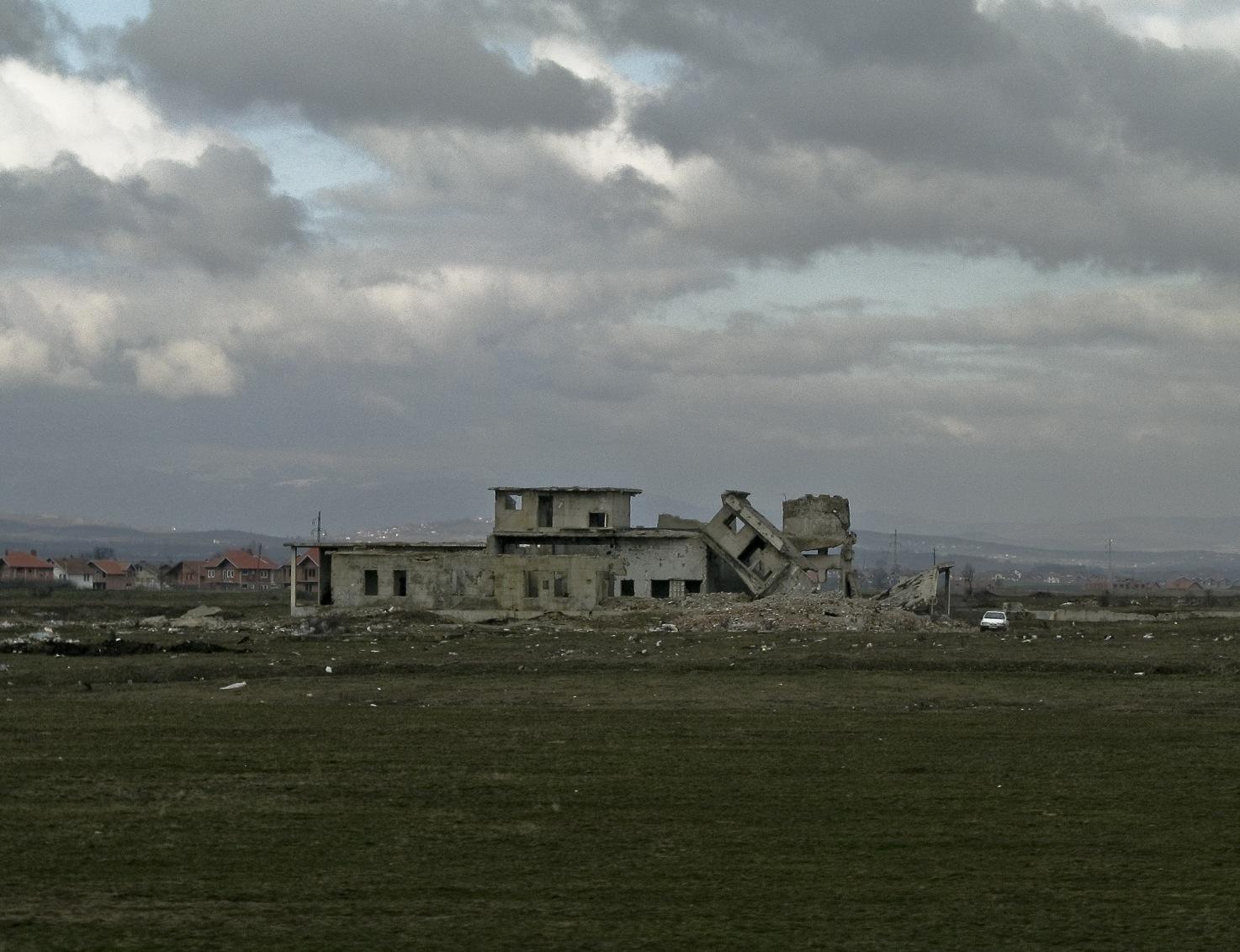 Antonis Lamnatos Bombed building in Kosovo;