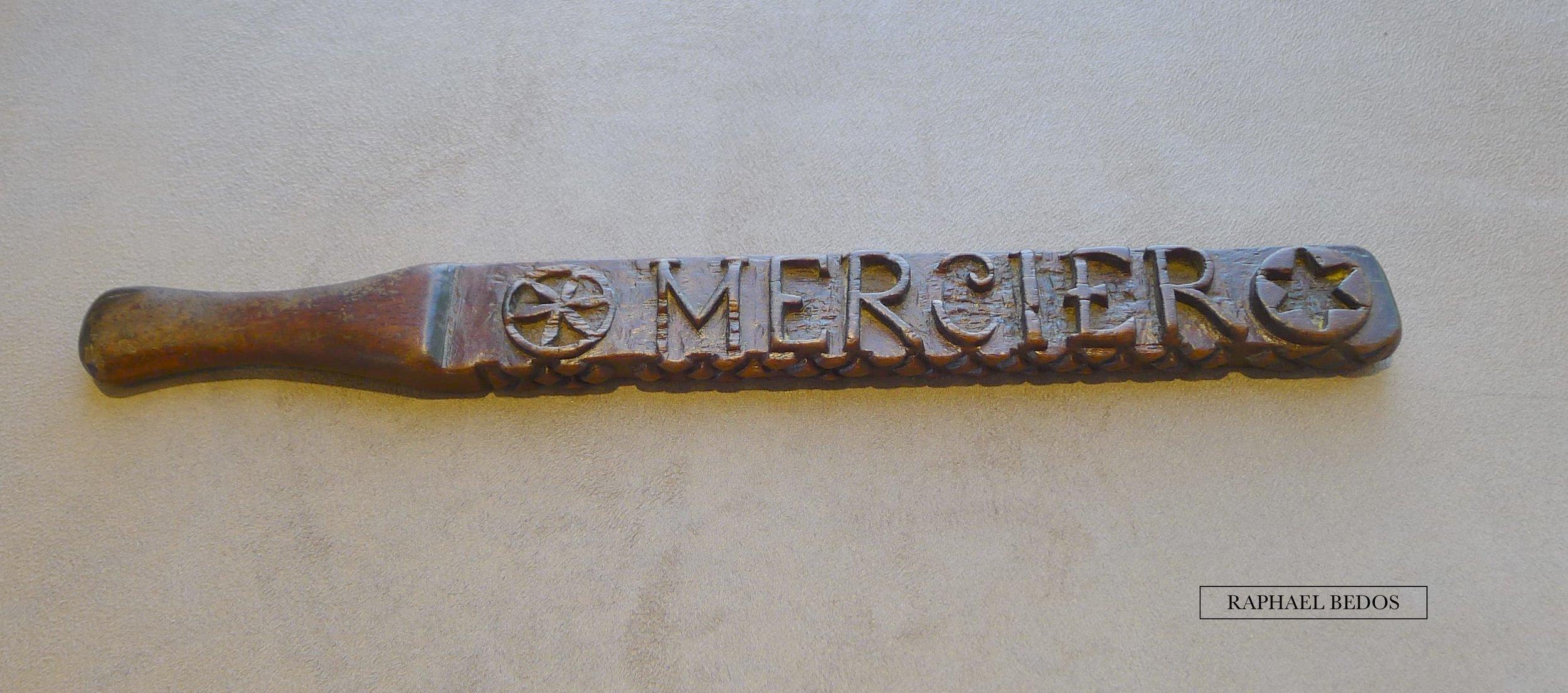 """10.Règle à beurre , patronne """"MERCIER""""cernéd'une rosace et d'une étoile (Lozère, L 30 cm)"""