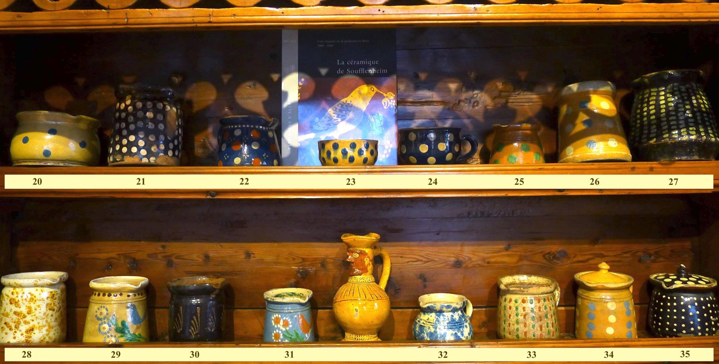 Etagère du haut :  pots d'Alsace à motifs à pois (n°21,22,25,26,27), bols (20,23,24)(H: 8 -21 cm)   Etagère du bas :  pots d'Alsace à motifs géométriques (n°32,33,34,35)(H : 13-18 cm), pots à crinoline(28,29,30,31)(H: 15 -19cm).Décor à l'éponge est assez rare (28)
