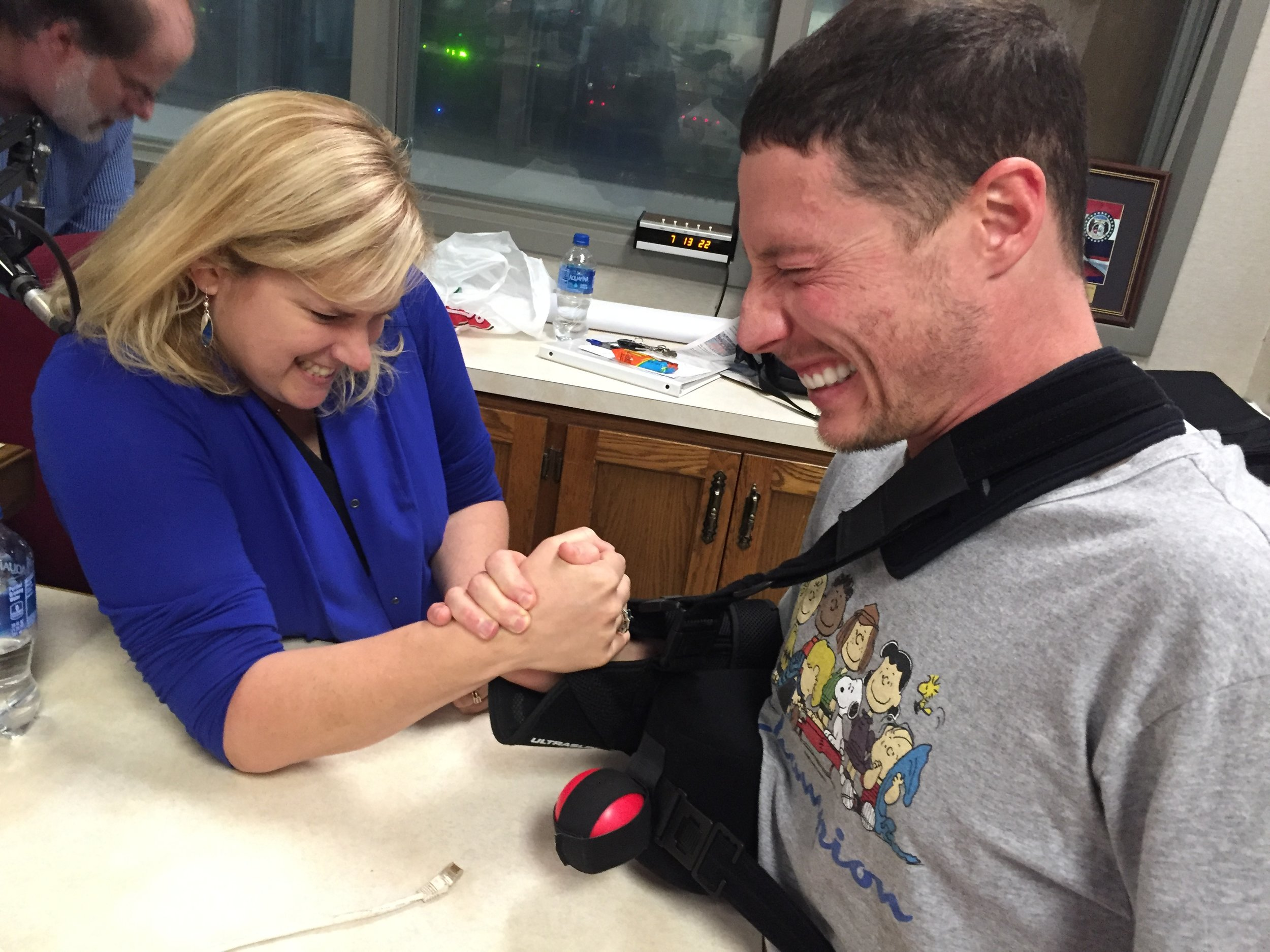 I challenge Lucas Harrell (in a sling after shoulder surgery) to an arm wrestling match……he still won. {Duane Darr-photo bombs}
