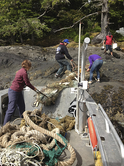 Highlander Marine staff and volunteers loading marine debris.
