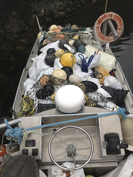 Looking down from the fly bridge on a full load of marine debris.