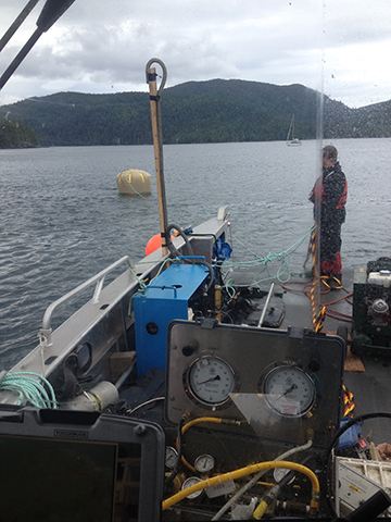 Our large heated cabins offer a warm dry place to monitor divers and their work. Here we are using a 6 tonne lift bag to move a mooring anchor.