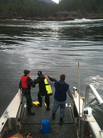 Entering the water to locate the wreck.
