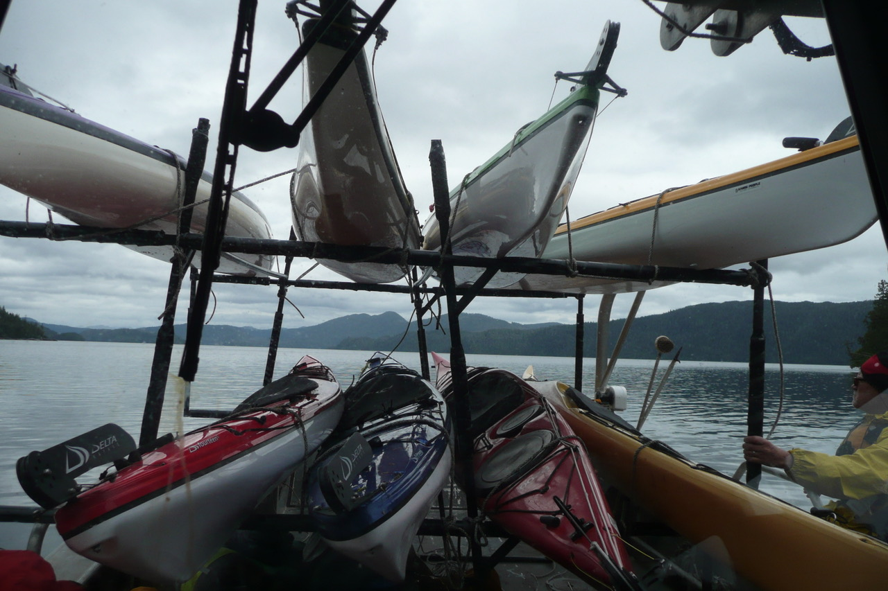 A custom built Kayak rack capable of carrying up to 10 kayaks with lots of room for gear, equipment and passengers too.