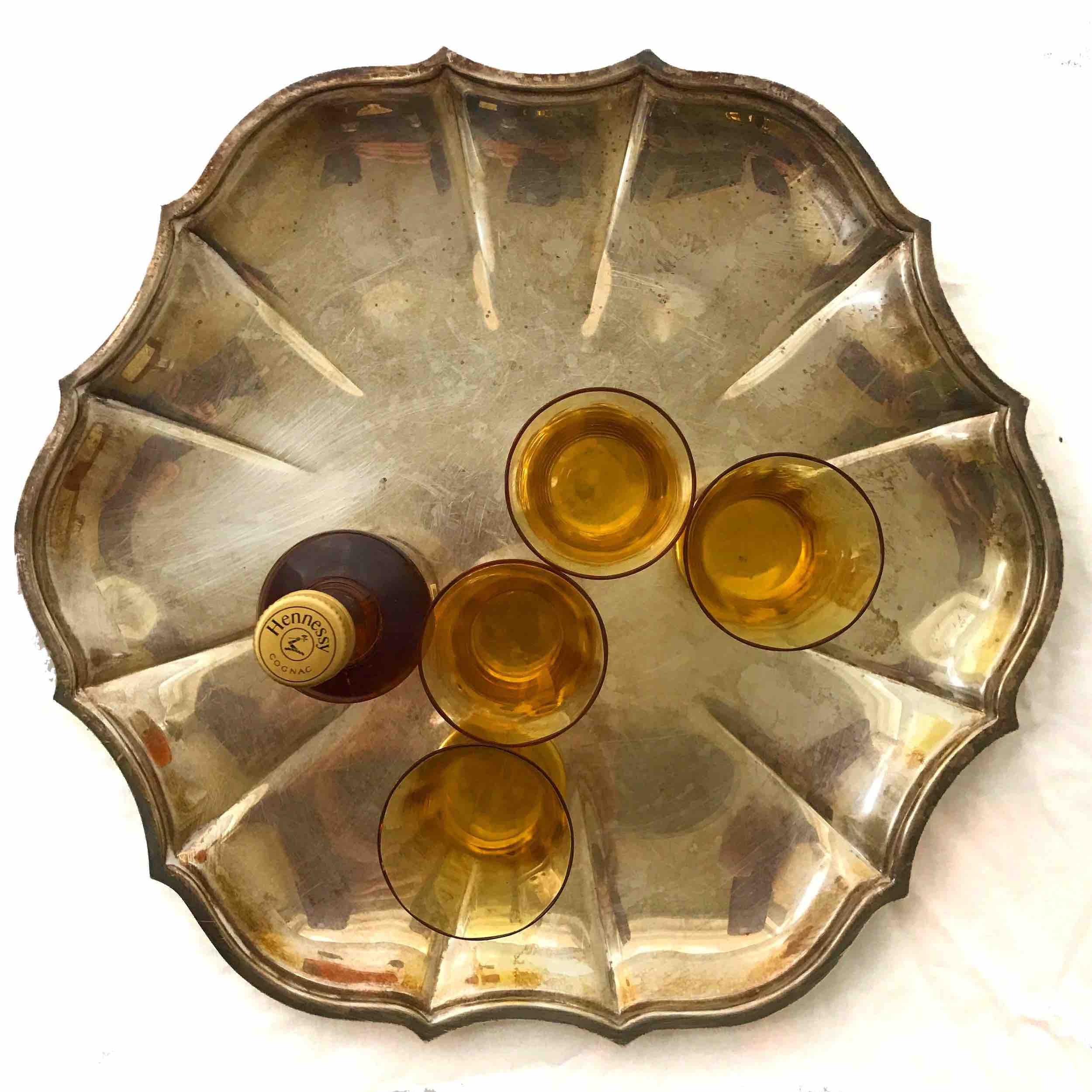 "#16: Four amber-colored cordial glasses on six-lobed silver plate. 2.5"" x 11"""