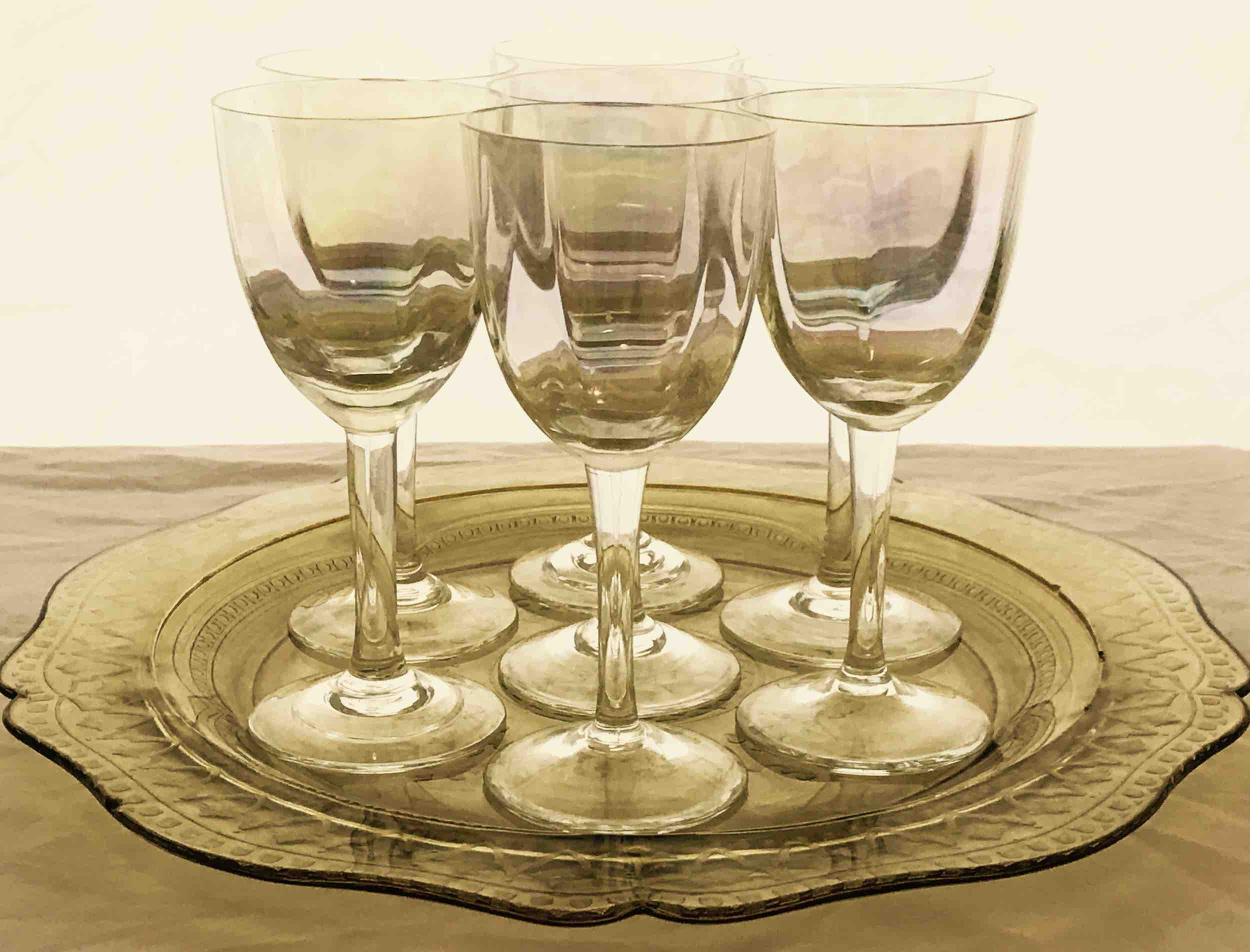 "#20: Seven iridescent apéritif glasses on yellow dinnerplate. 5.5"" x 11"""