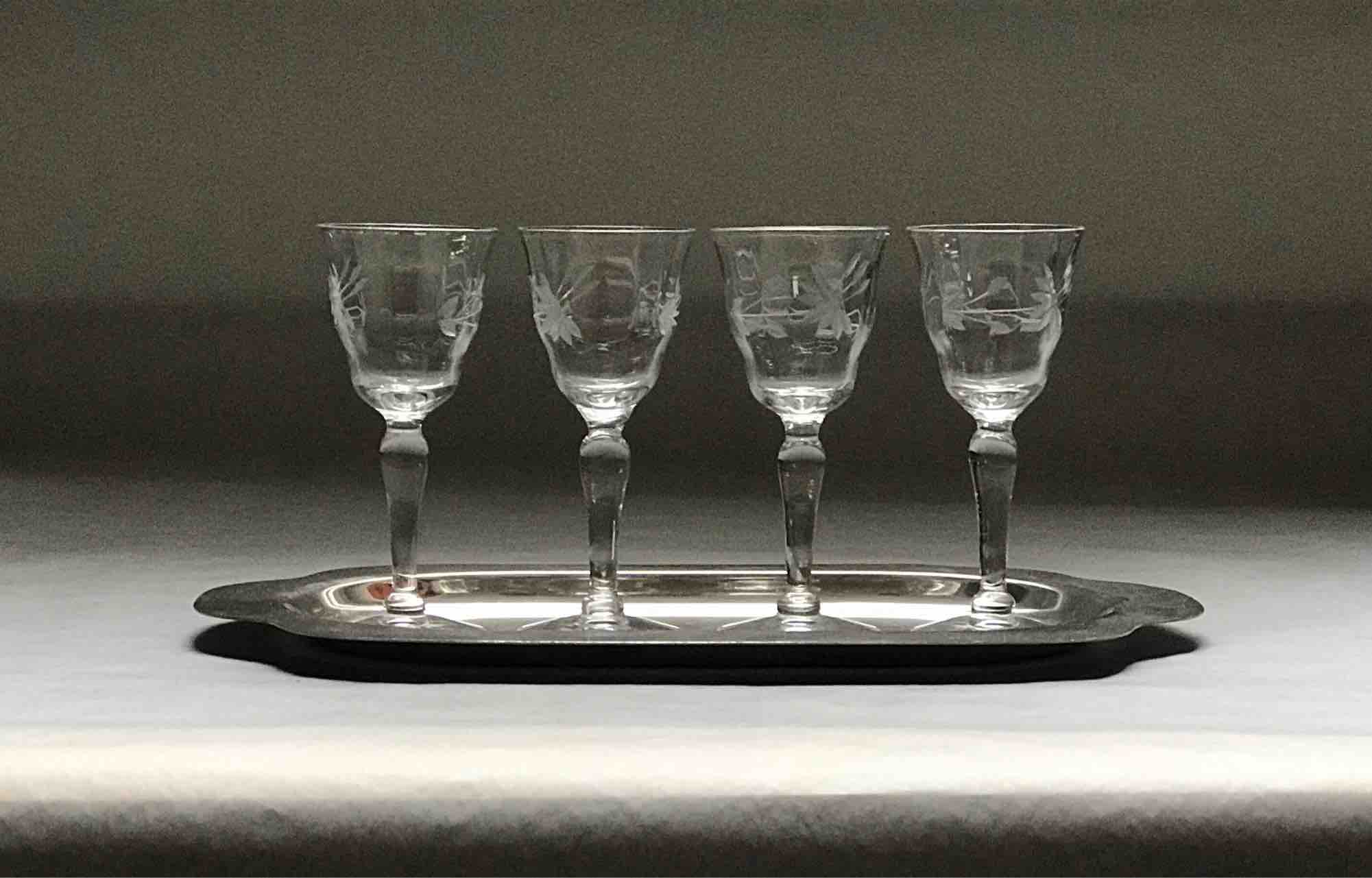 "#25: Four etched cordial stems on oblong, four-lobed silver plate. 4"" x 10"" x 6"""