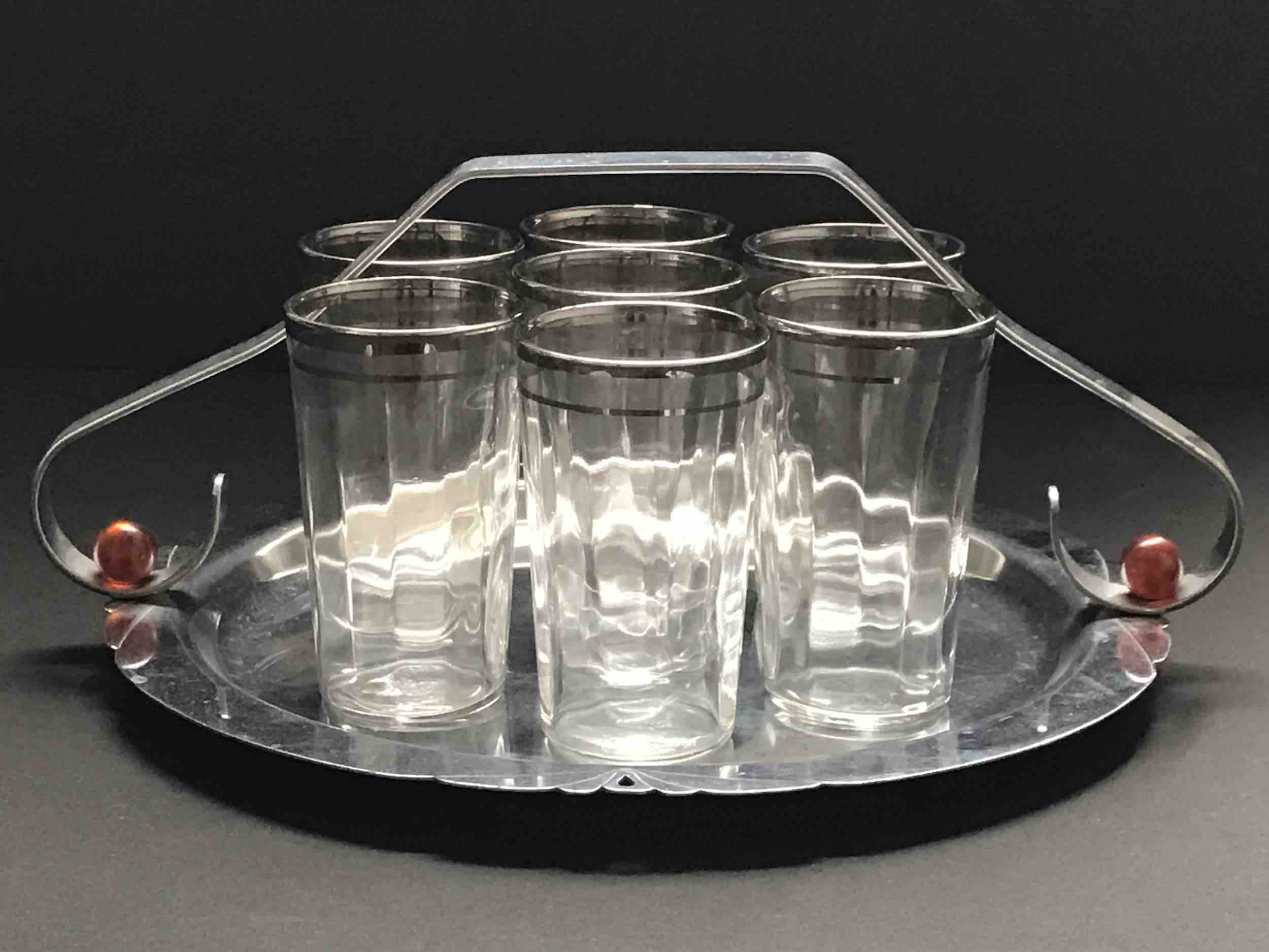 "#31: Seven ribbed, silver-trimmed tumblers on tidbit tray with  handle and  red baubles. 4"" x 10"""