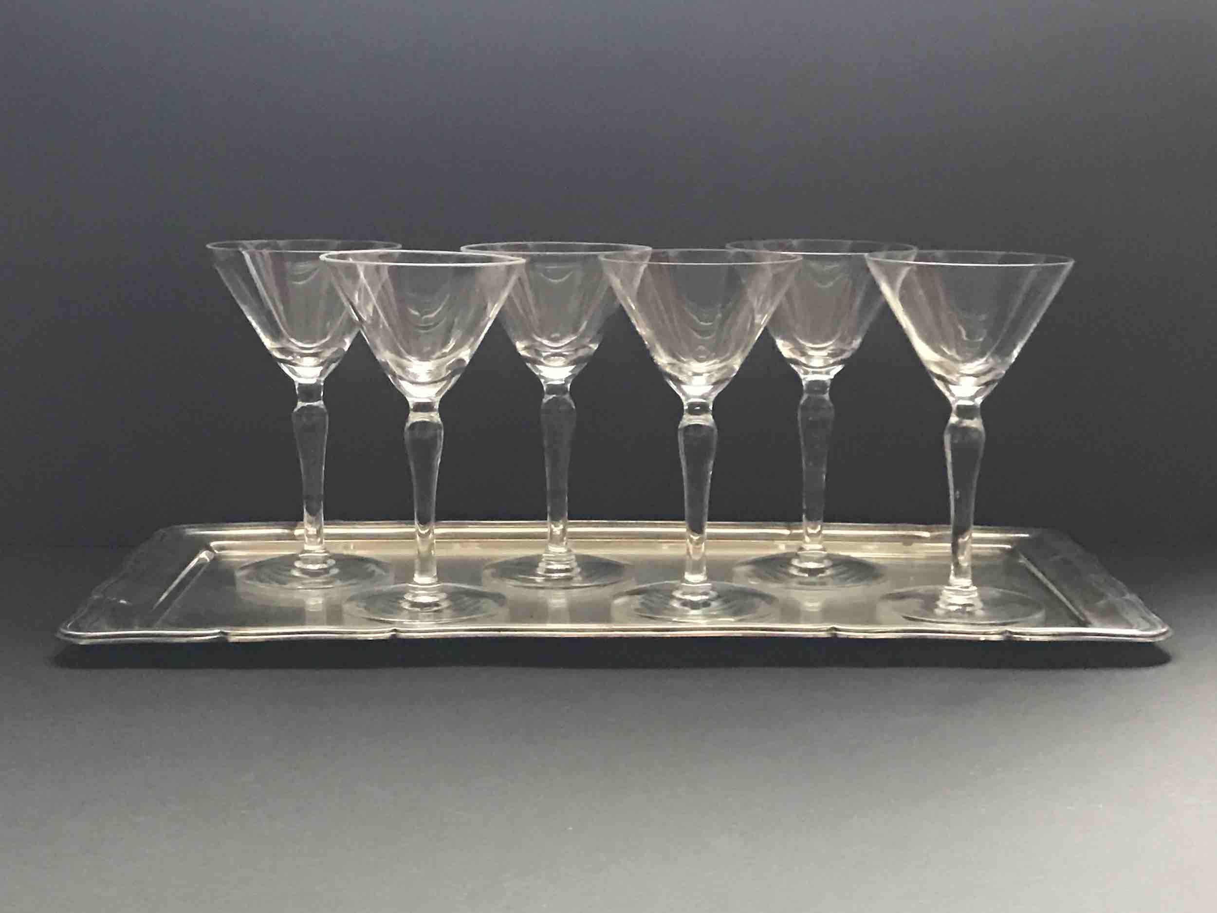 "#15: Six ""demi-martini"" glasses on rectangular silver tray with carved edges and glass inset. 5.5"" x 15"" x 8"""