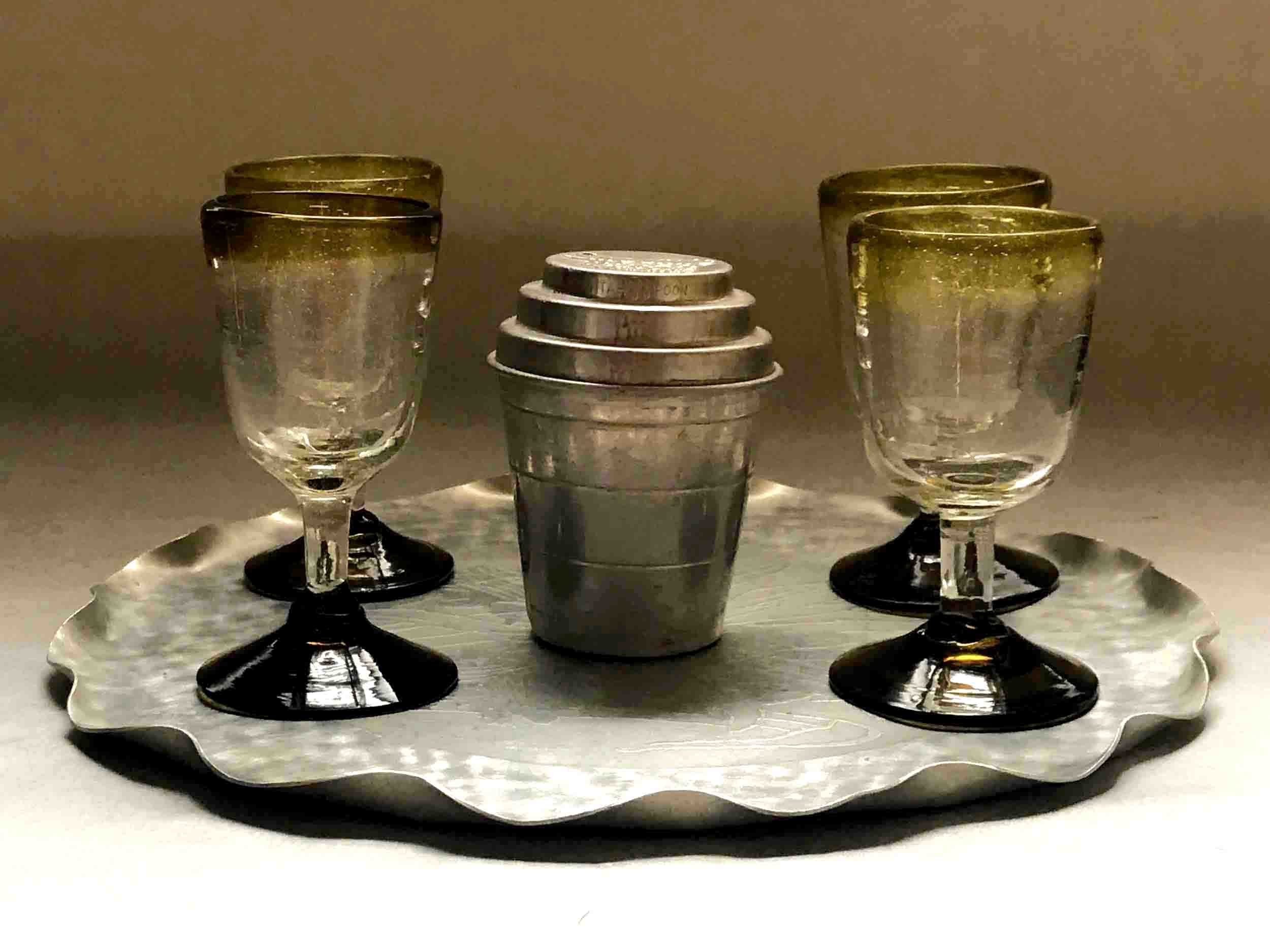 "#21: Mini ""Smoothie Mixer"" and four handblown Mexican goblets with amber rims and feet on tray with hammered texture and etched floral motif. 5.5"" x 16"" x 11"""