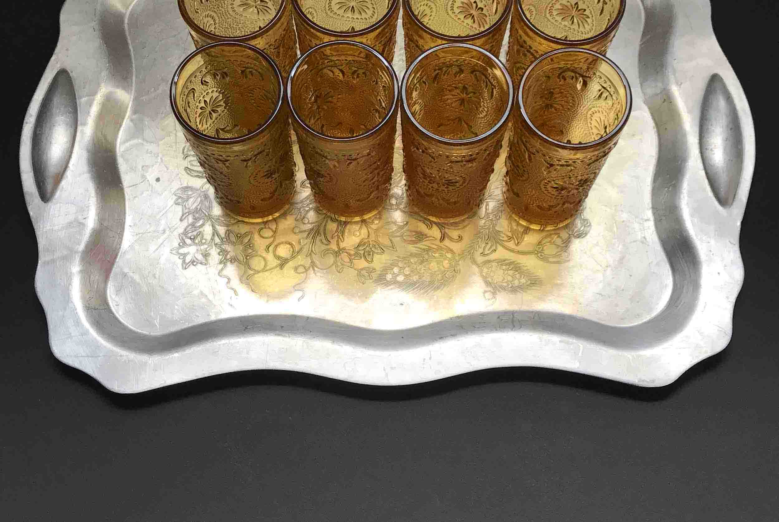 "#18: Eight pressed glass tumblers on moulded silver tray  engraved with floral design. 4"" x 16"" x 11"""