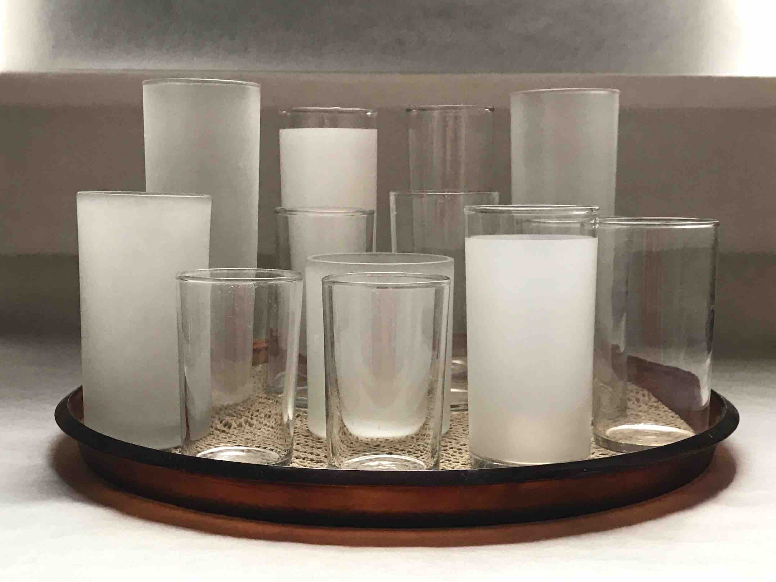"#24: Twelve assorted Collins glasses glasses on tortoiseshell plastic tray lined with no-slip latex. 7.5"" x 12"""