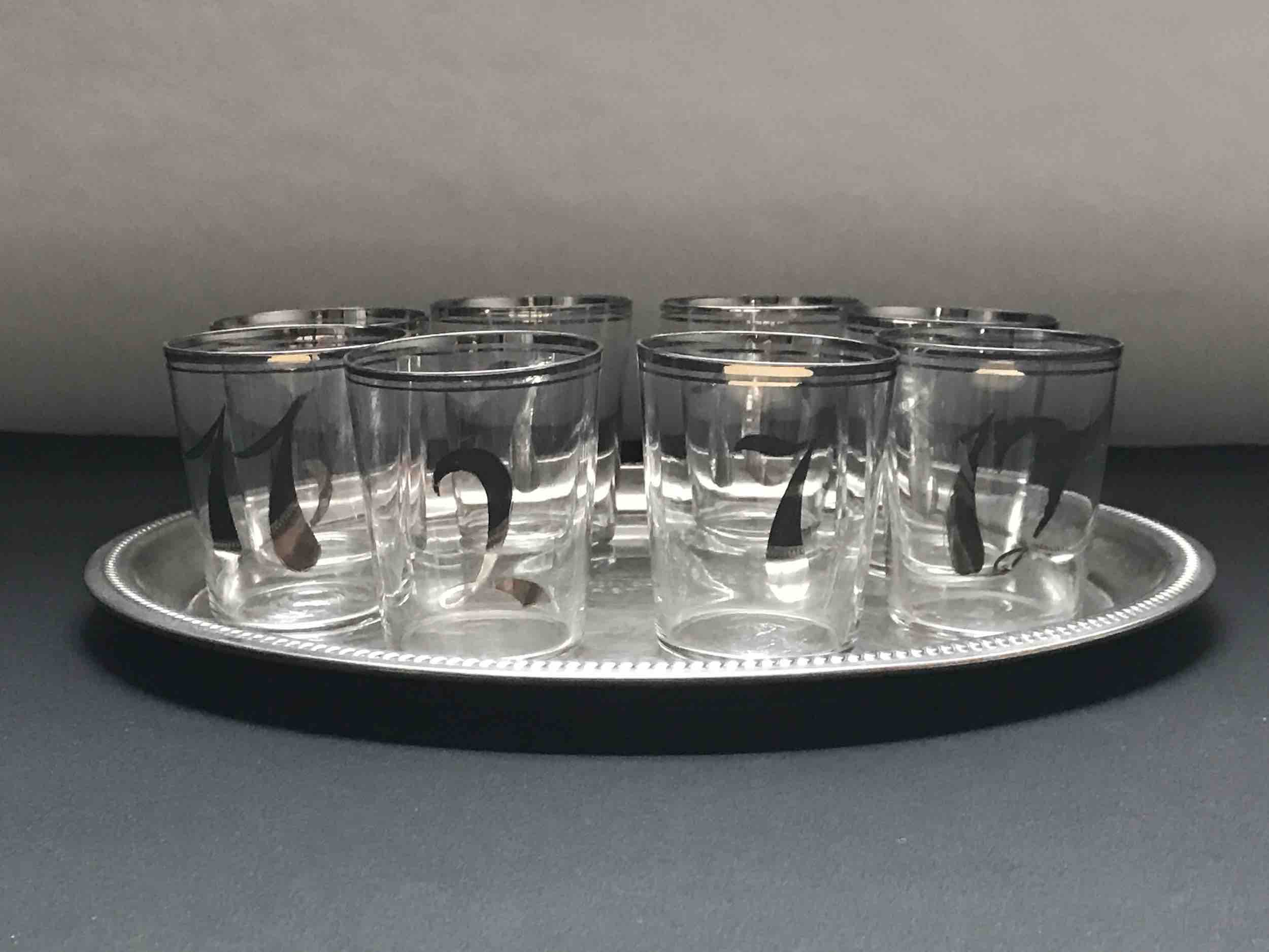"#17: Eight tumblers hand-numbered in silver on platter engraved ""Betty Crocker Chiffon Cake Award, First Prize."" 3"" x 11"""