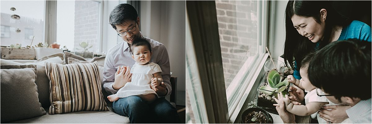 nyc family and newborn photographer mom holds baby girl while she plays with living room plants