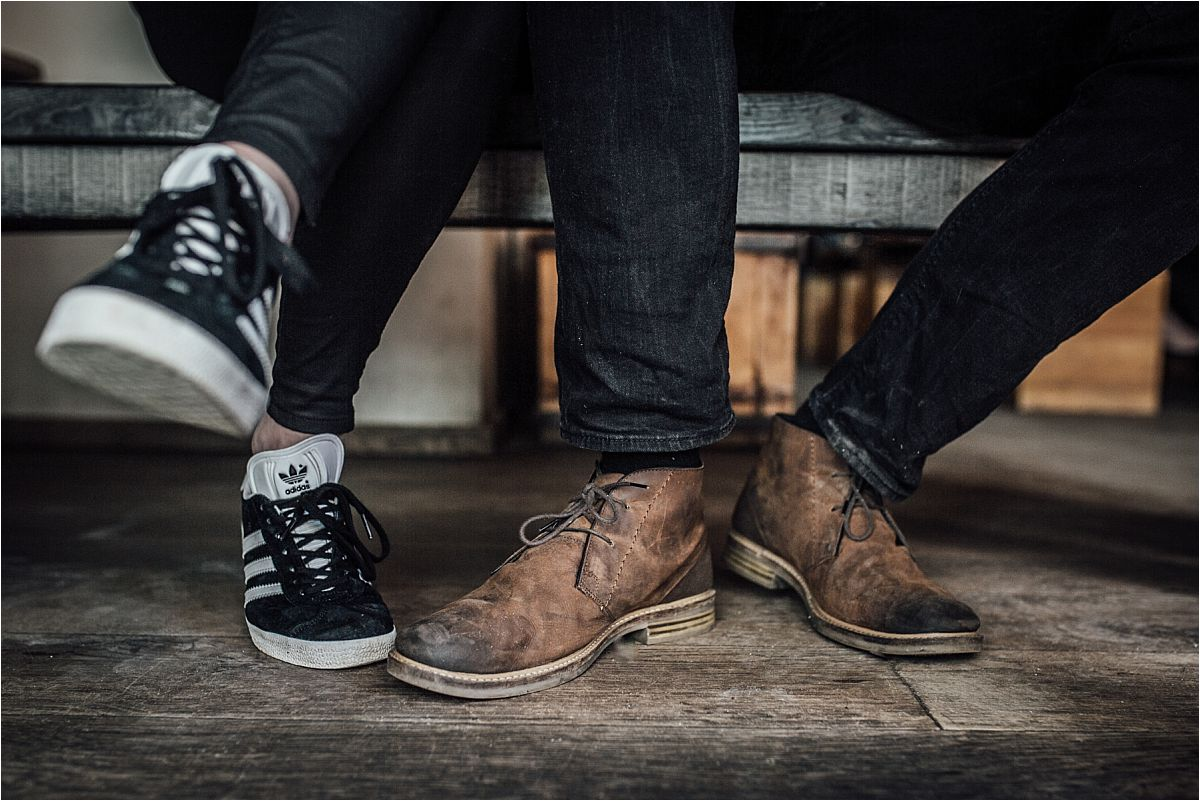 nyc newborn and family photographer trendy shoes in cafe