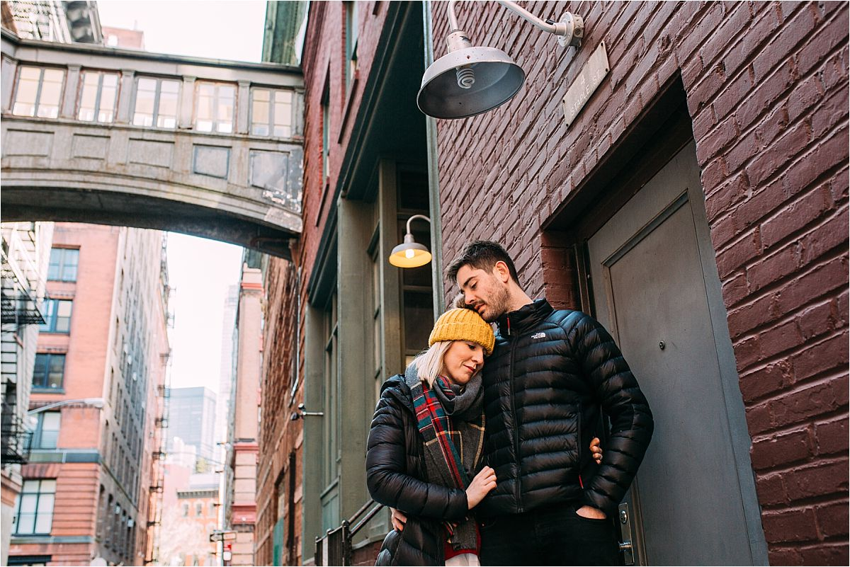 nyc newborn and family photographer married couple cuddle on staple st
