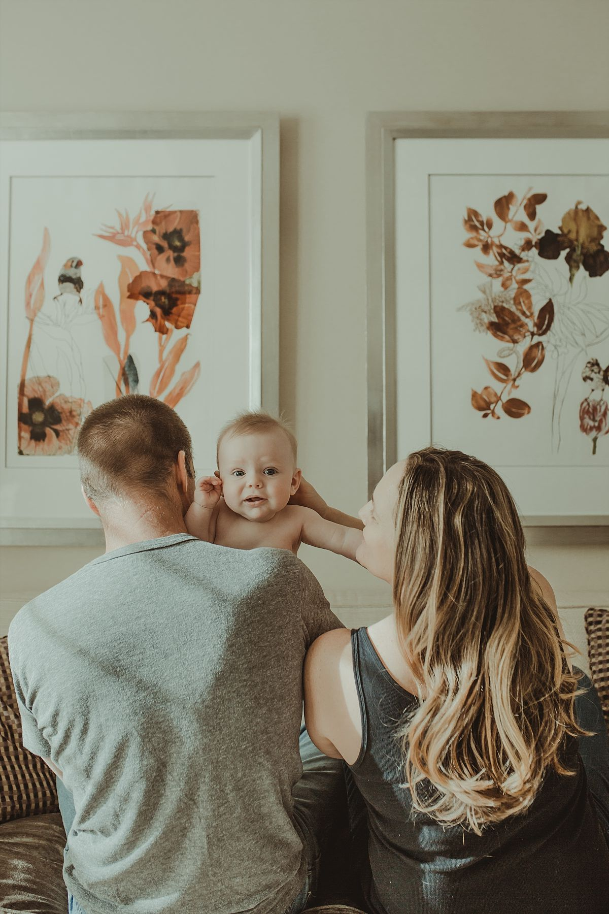 nyc newborn and family photographer dad holding baby and baby peeking over shoulder