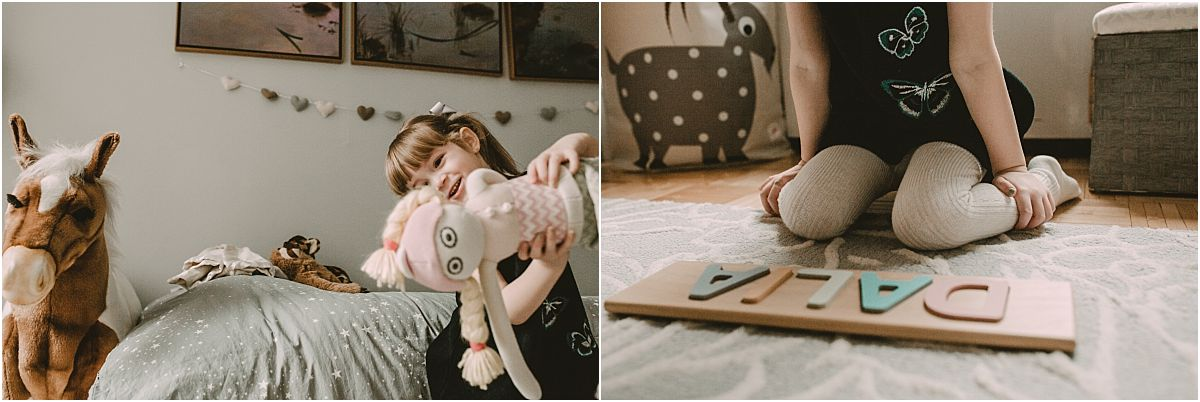 nyc family and newborn photographer big sister spells out name with wooden toy letters