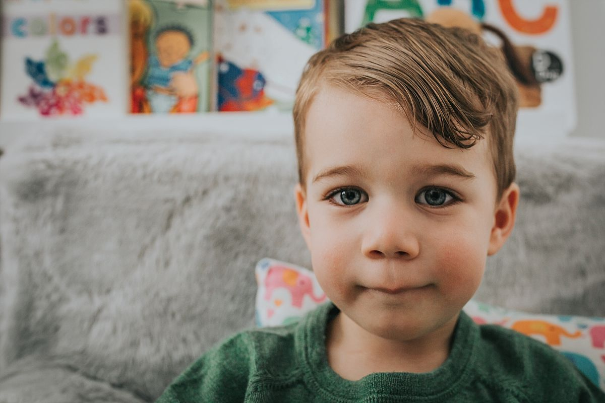nyc family and newborn photographer toddler son and his amazingly beautiful blue eyes