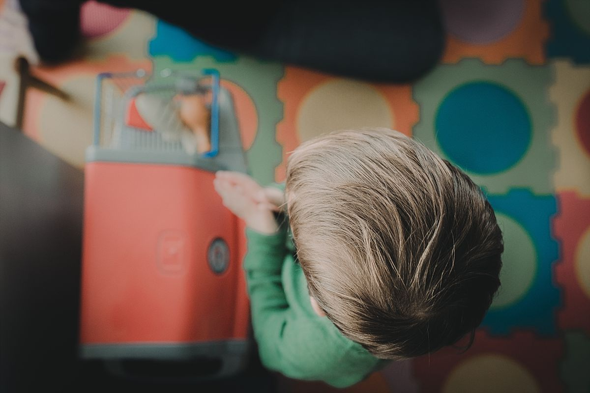 nyc family and newborn photographer birds eye view of toddler son playing at cooking station
