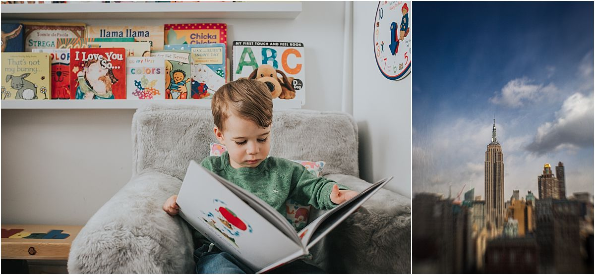 nyc family and newborn photographer toddler boy reads book in room sitting on grey chair