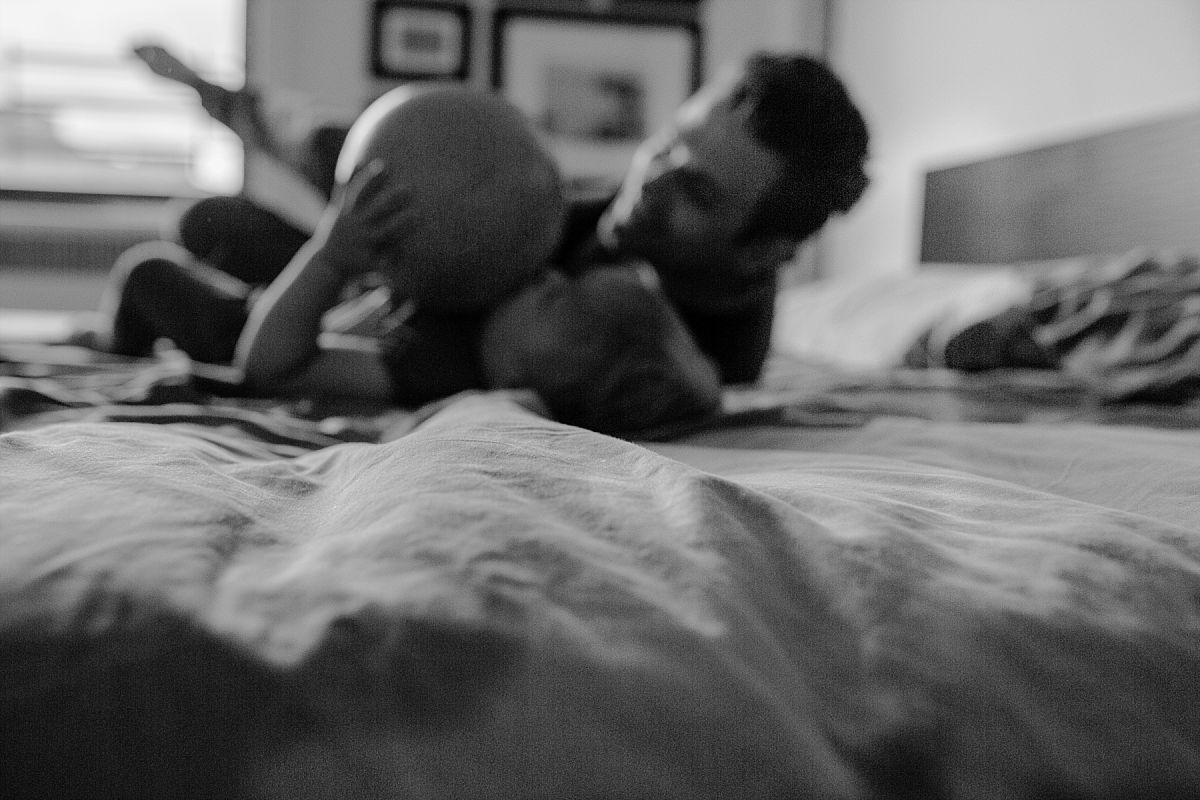 nyc family and newborn photographer father and son in blurred black and white photo in new york city