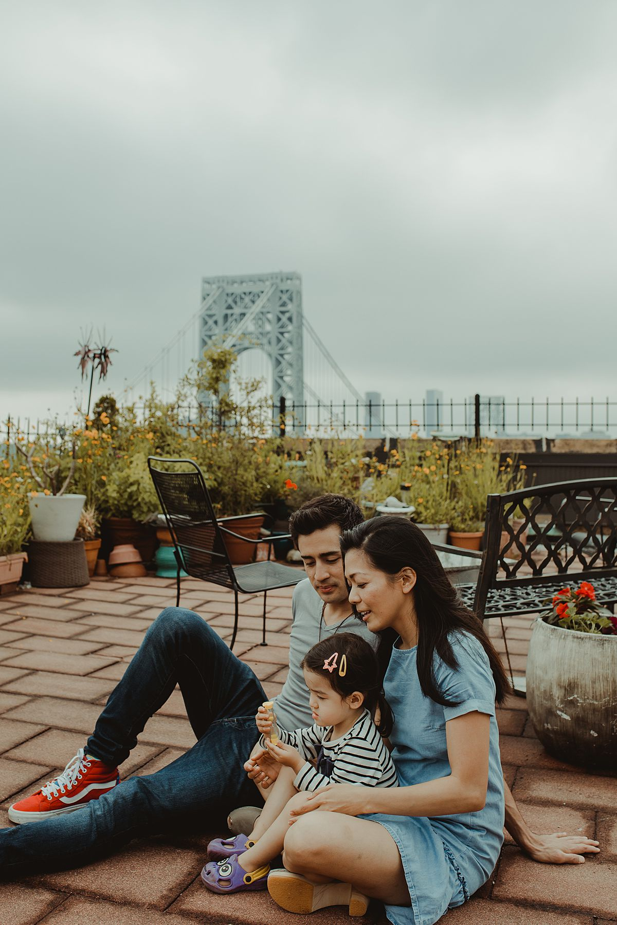 beautiful rooftop photo of a lovely, bubbly energetic family of three
