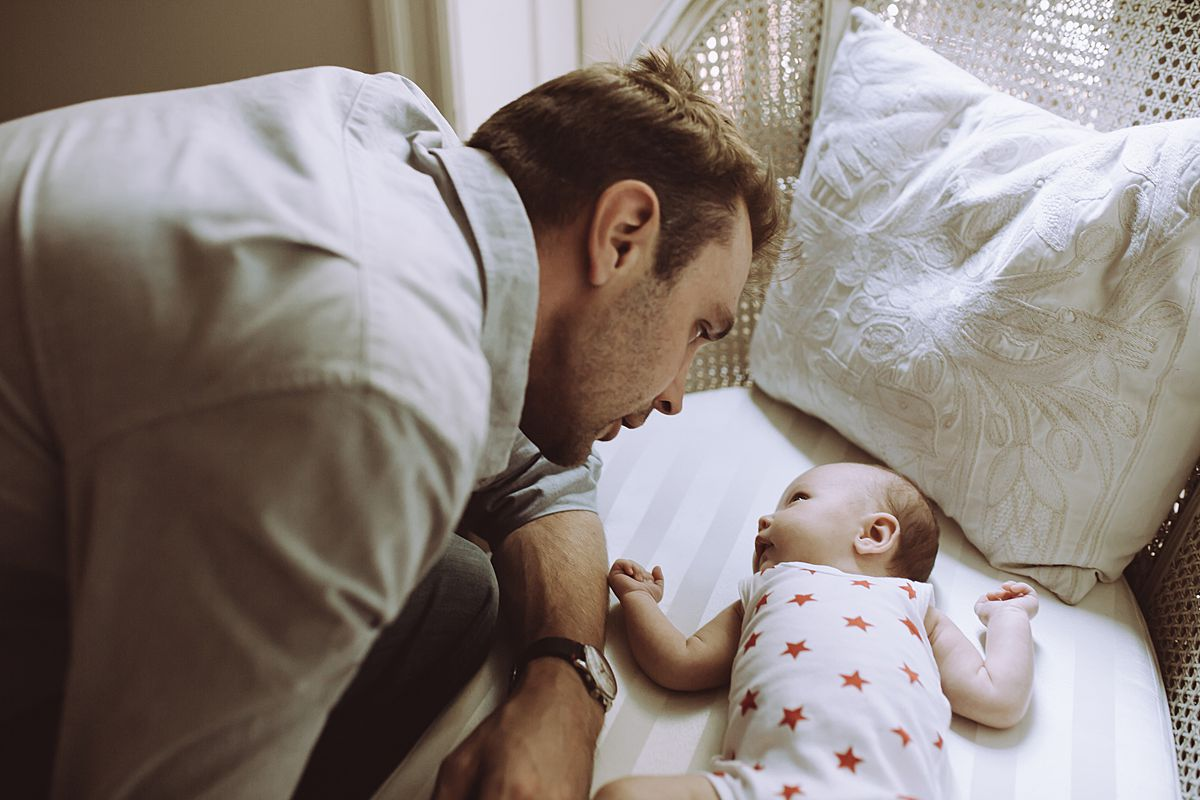 dad and daughter have a moment. image by nyc family and newborn photographer krystil mcdowall