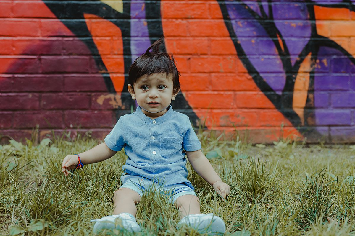 photo of son in front of colorful graffiti wall in dumbo