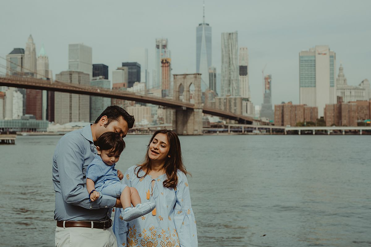 son, mom and dad close up in dumbo brooklyn. photo by nyc family and newborn photographer krystil mcdowall