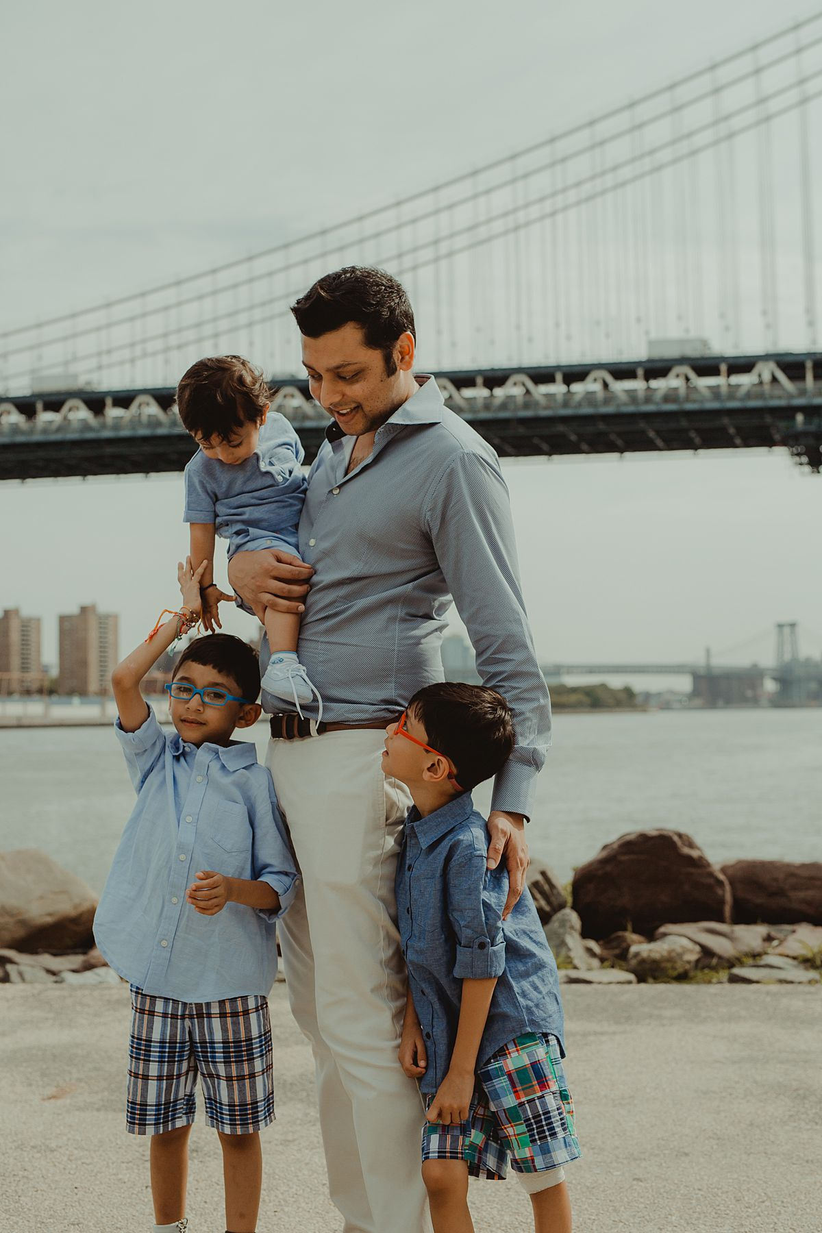 dad with son and nephews in front of manhattan bridge. photo by krystil mcdowall