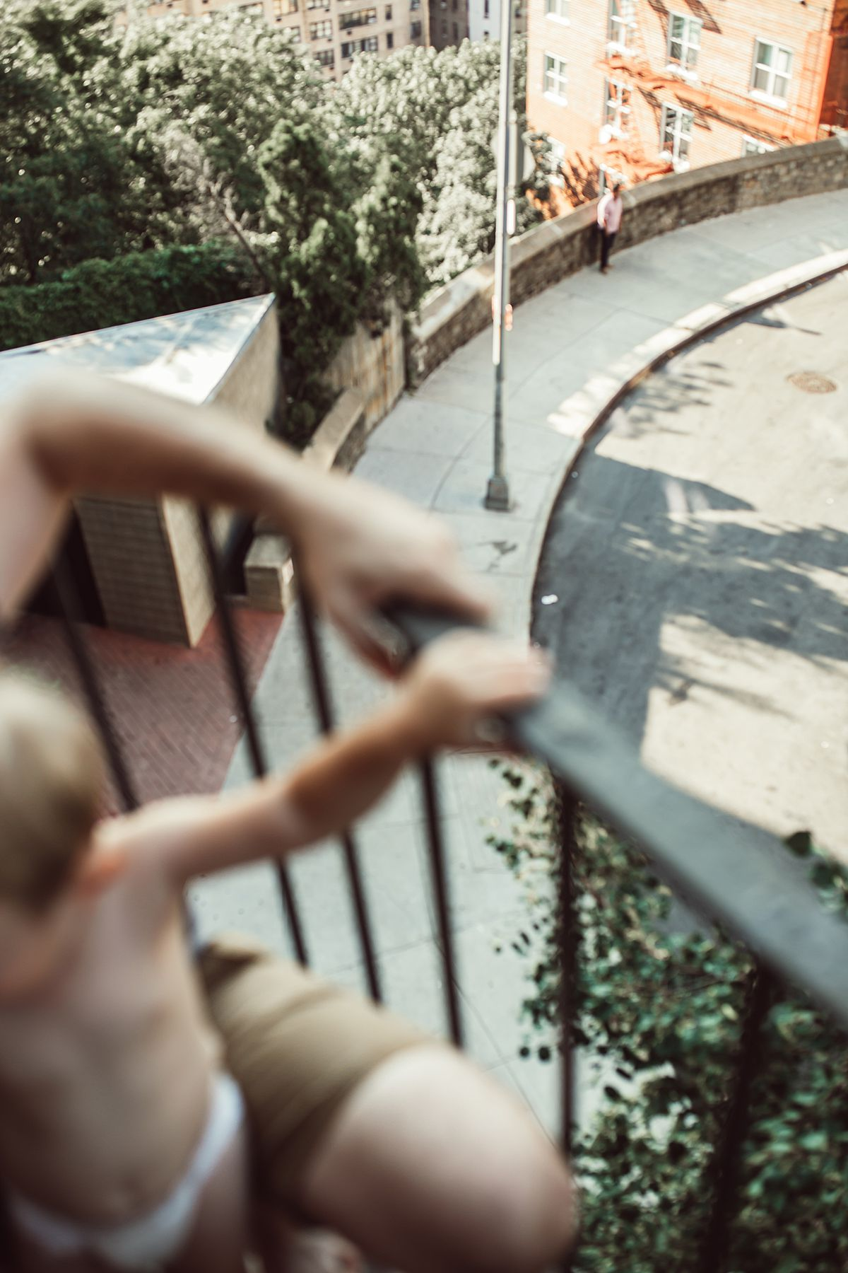 blurred detail shot of dad and son's hands holding railing on their nyc fire escape. image by photographer krystil mcdowall