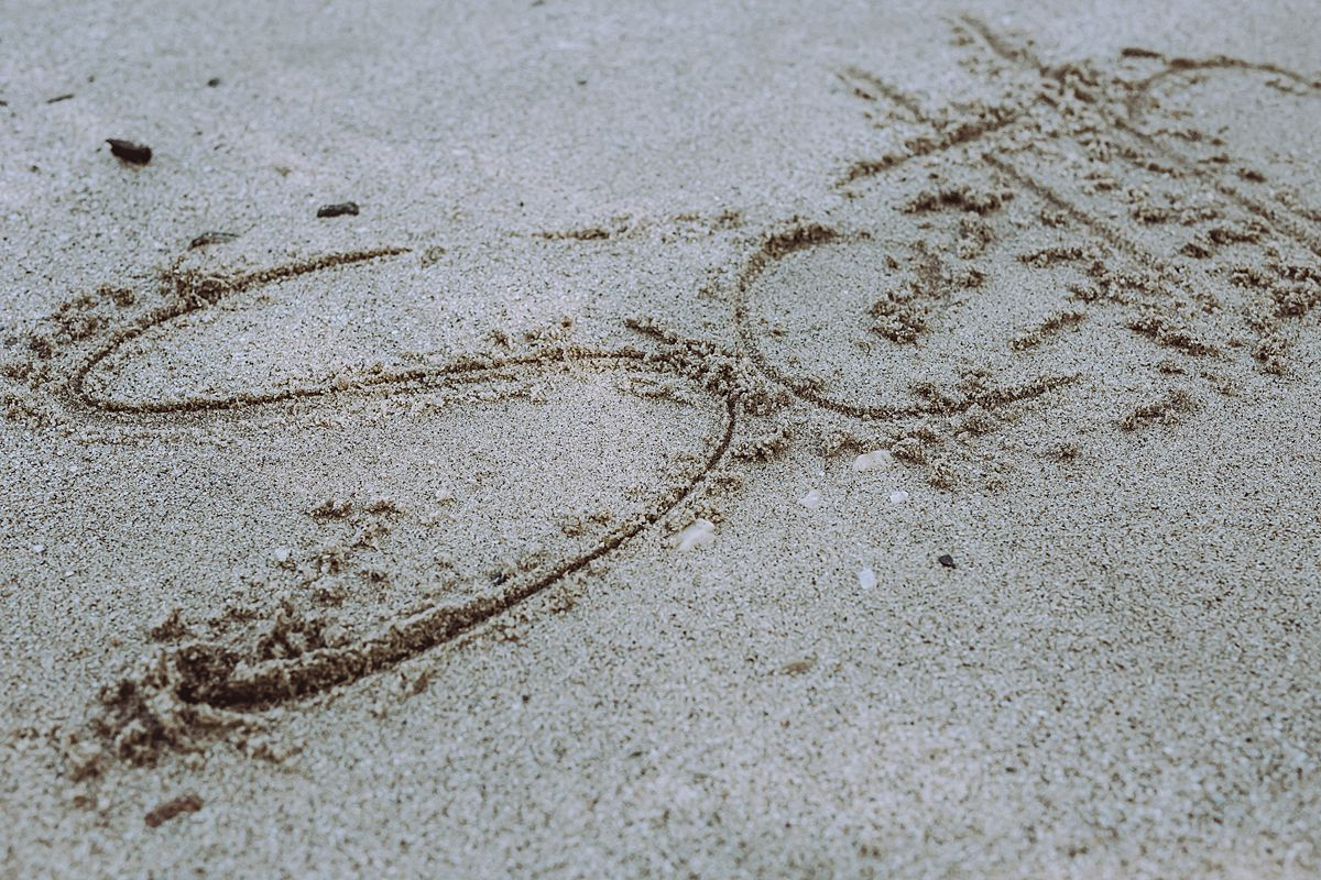 picture of son's name scrolled into sand by the hudson river in washington heights nyc