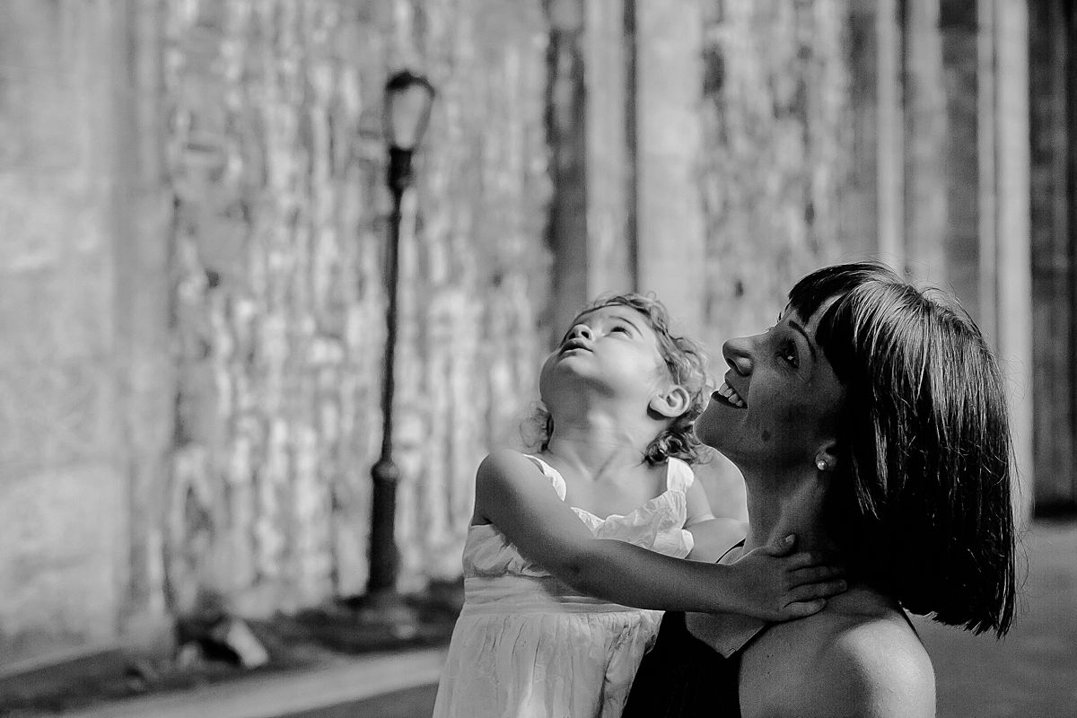 mom and toddler exploring big concrete park arches of beautiful fort tryon park in new york city. photo by krystil mcdowall photography