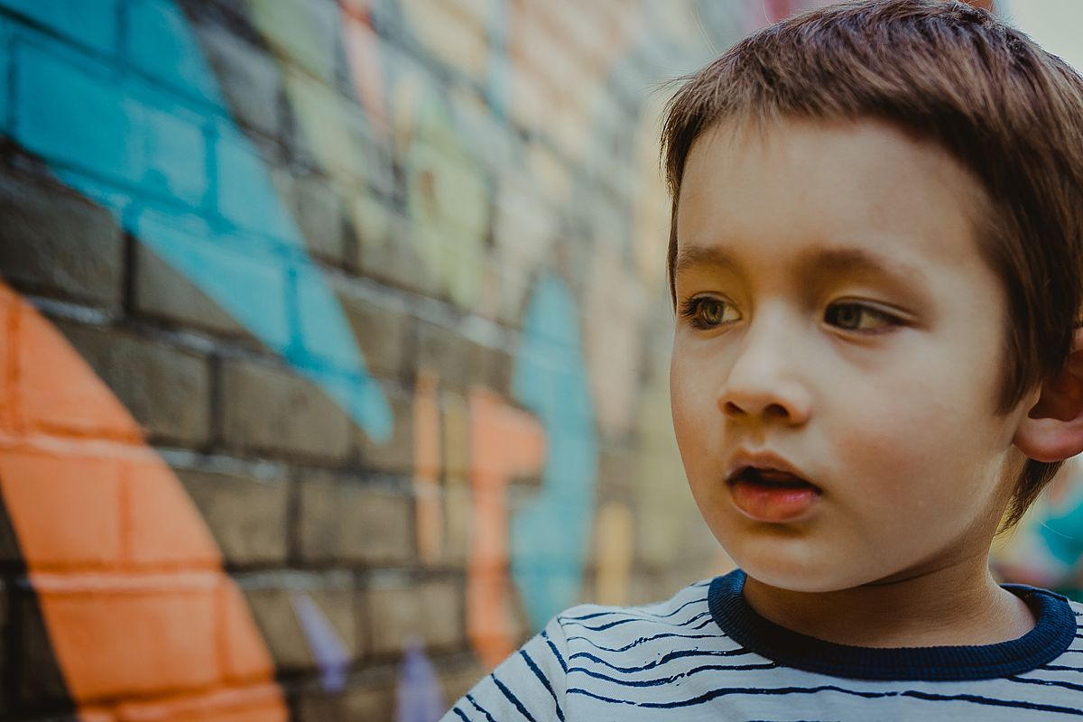 close up portrait of cute boy in dumbo brooklyn
