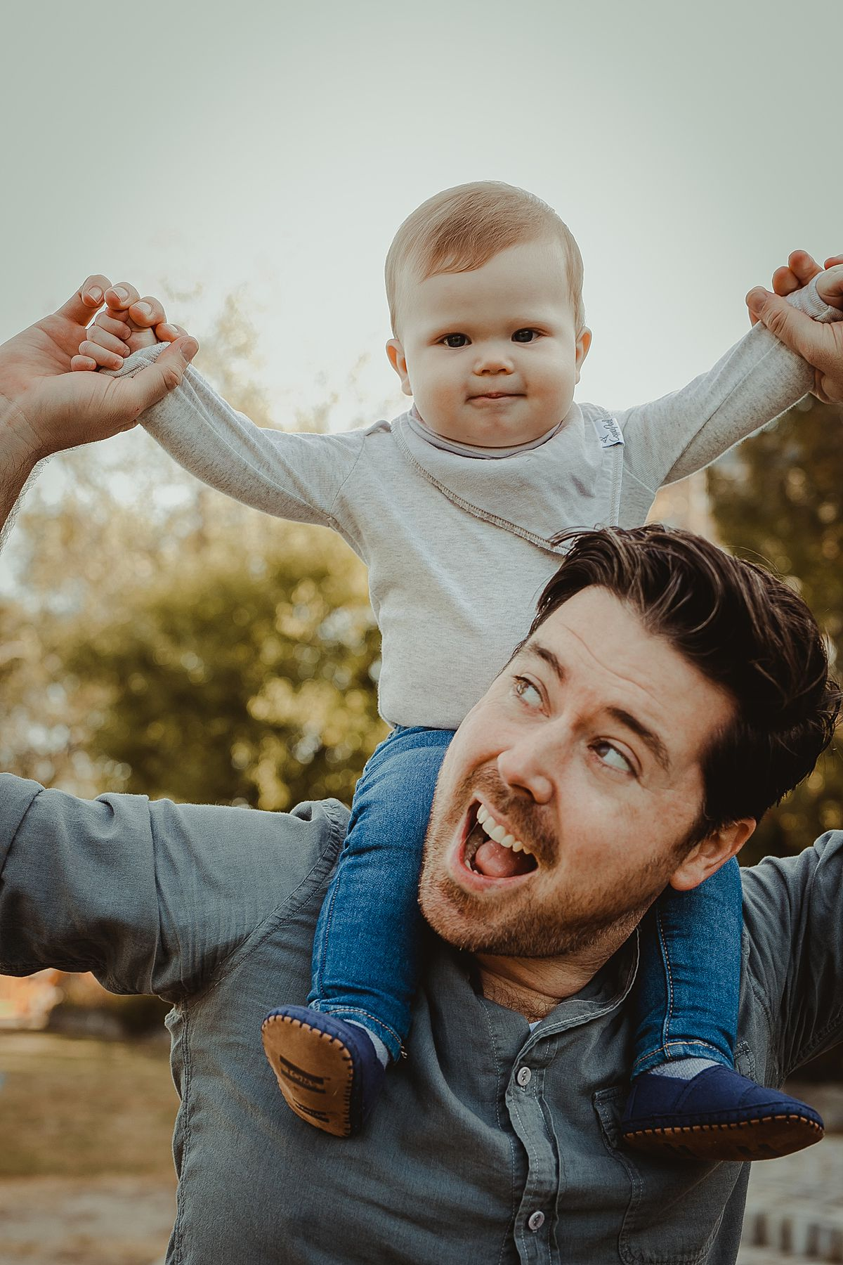 son enjoying shoulder ride at local park in queens. image by photographer krystil mcdowall