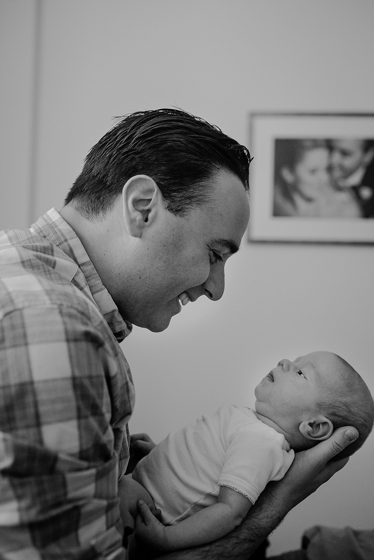 dad holds newborn daughter during family lifestyle session in downtown manhattan. photo by nyc newborn photographer krystil mcdowall