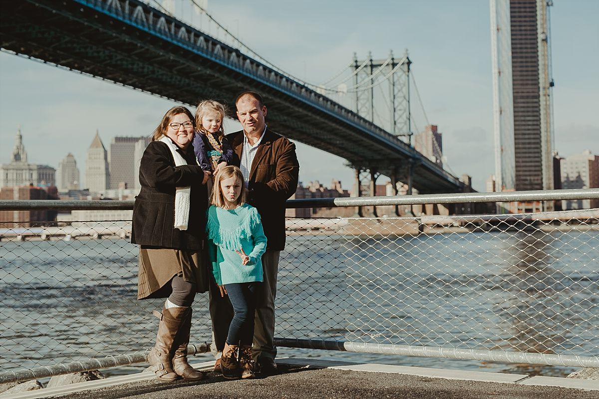 family portrait in front of the manhattan bridge. image by nyc family photographer krystil mcdowall
