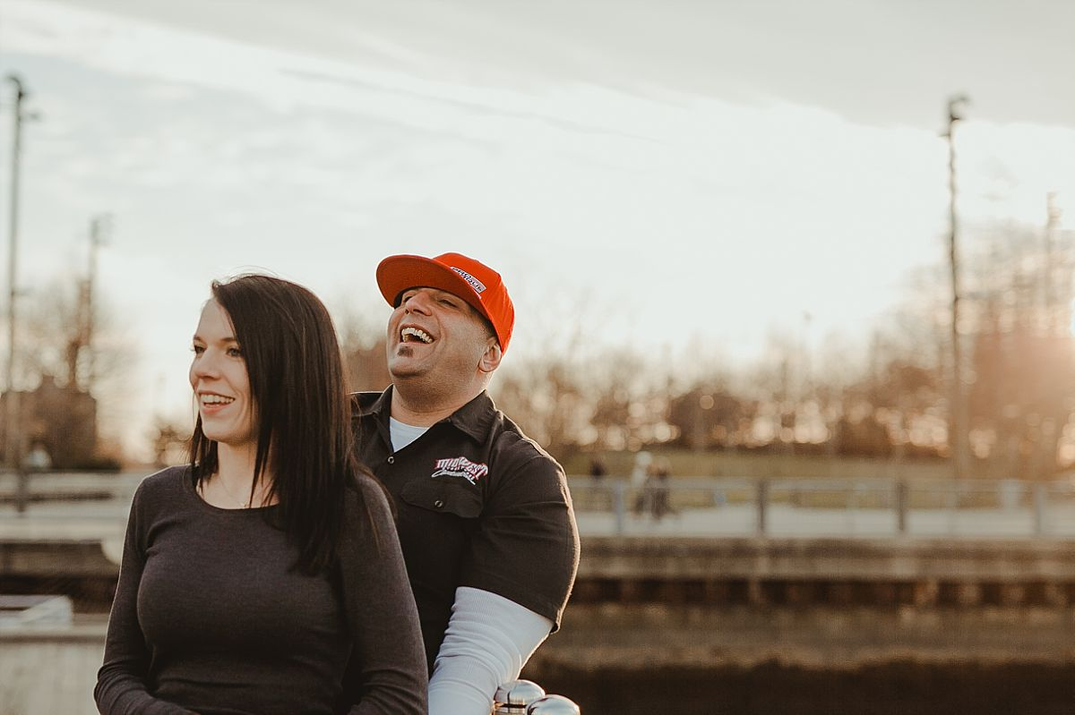 candid photo of couple at pier in brooklyn bridge park. photo by nyc family photographer krystil mcdowall
