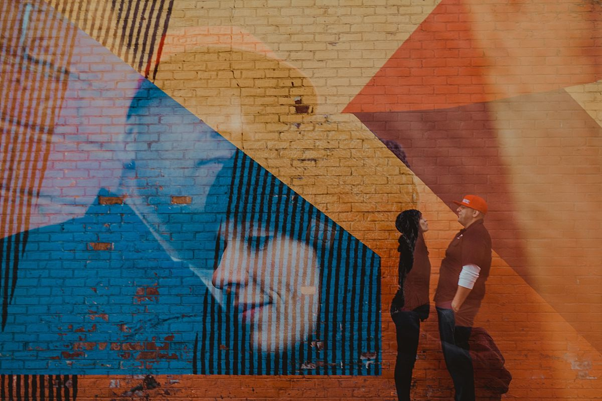double exposure photo of couple in front of colorful graffiti mural in brooklyn. photo by nyc family photographer krystil mcdowall